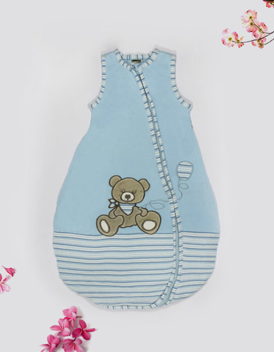 teddy-bear-on-blue-baby-bed-featured